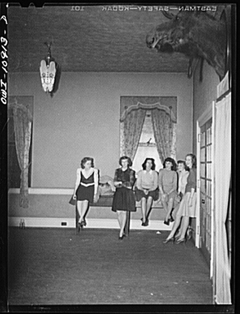 Lancaster, Pennsylvania. Company dance given in Moose Hall by employees of the Hamilton Watch Company so that new employees might get acquainted. Extra girls chatting in the hall outside the dance floor