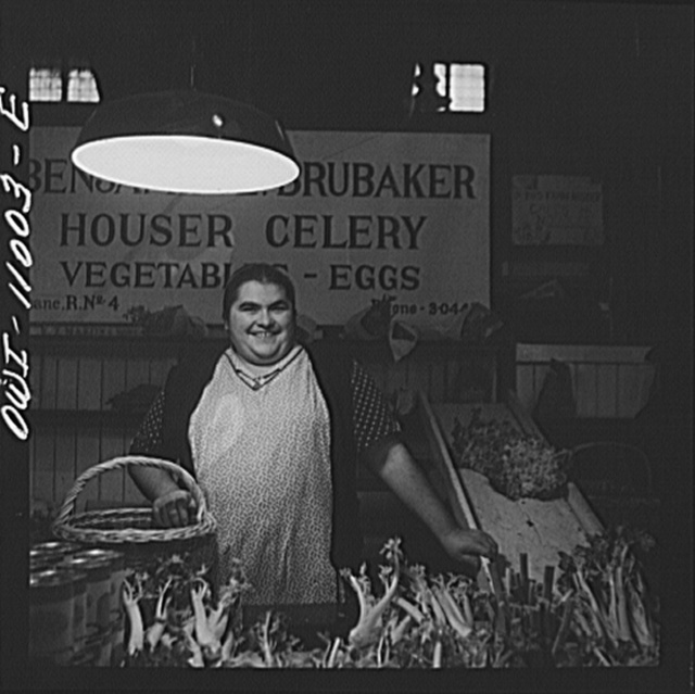 Lancaster, Pennsylvania. Mennonite farm woman at her stall in the Central Market