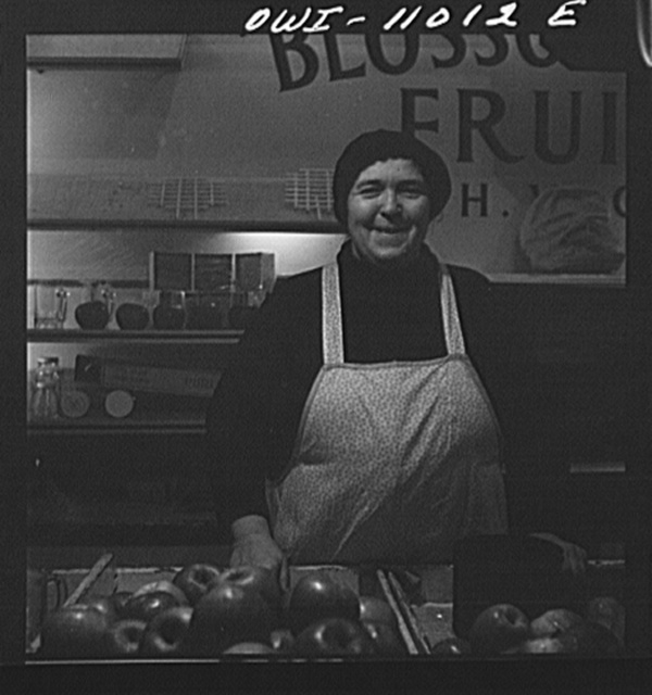 Lancaster, Pennsylvania. Mennonite farmer's wife at her stall in the central market