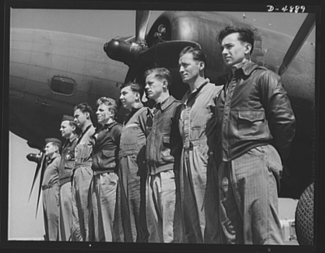 Langley Field, Virginia. YB-17 bombardment squadron. A combat crew of one of our mighty YB-17 bombers lines up before a warship of the skies. A captain and lieutenant act as pilot and co-pilot. Two sergeants and four corporals man the machine guns, radio and other equipment. All belong to a bombardment squadron stationed at Langley Field, Virginia