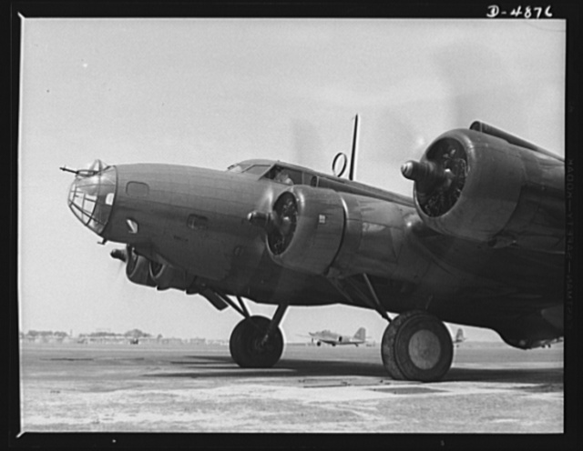 Langley Field, Virginia. YB-17 bombardment squadron. A giant of the airways poises for flight. The four powerful engines of a YB-17 bomber are warmed up before takeoff at Langley Field, Virginia