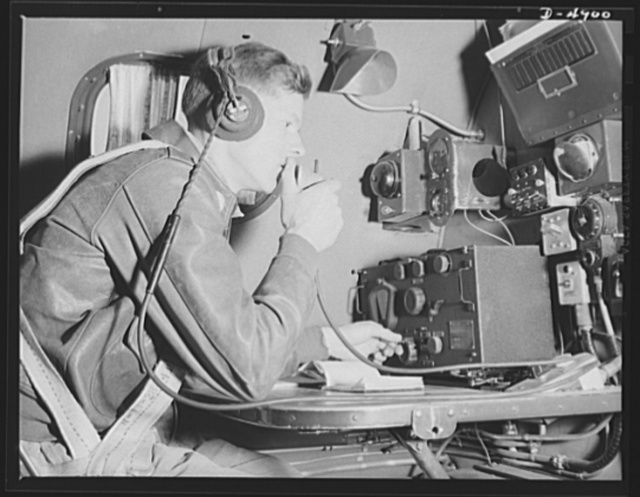 Langley Field, Virginia. YB-17 bombardment squadron. A staff sergeant of a bombardment squadron serves as radio operator on a huge YB-17 bomber. He is reporting to his home base at Langley Field, Virginia