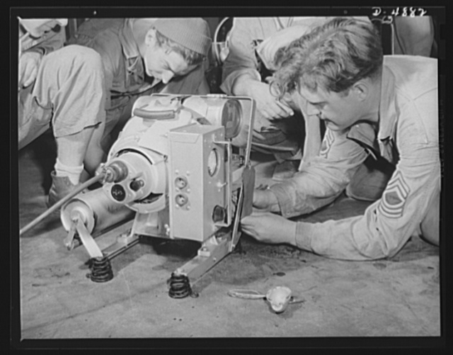 Langley Field, Virginia. YB-17 bombardment squadron. A technical sergeant and a master sergeant of a bombardment squadron at Langley Field, Virginia adjust a field lighting unit that plays an important part in their operations