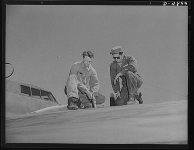 Langley Field, Virginia. YB-17 bombardment squadron. A warship of the skies takes on a load of fuel. Two corporals of a bombardment squadron at Langley Field, Virginia fill the gas tanks of a huge YB-17 bomber just before takeoff