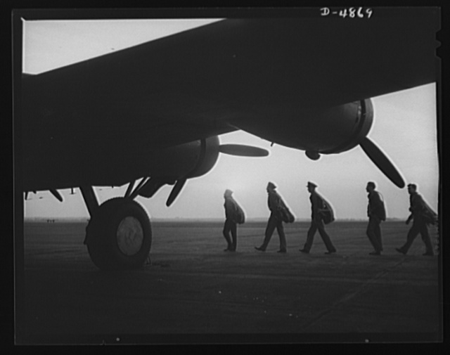 """Langley Field, Virginia. YB-17 bombardment squadron. """"By the dawn's early light."""" A combat crew ready to board a mighty YB-17 bomber on a dawn patrol flight from Langley Field, Virginia"""