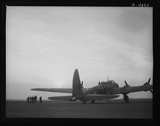 Langley Field, Virginia. YB-17 bombardment squadron. Duck patrol. A combat crew marches toward a giant YB-17 bomber to begin a patrol flight from Langley Field, Virginia