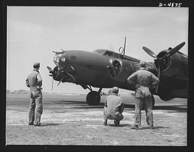 Langley Field, Virginia. YB-17 bombardment squadron. Every note from the power plants of the big planes has a meaning for the men of this bombardment squadron. A maintenance crew listens alertly while the pilot of a mighty YB-17 bomber warms up the first of his four powerful engines for a takeoff from Langley Field, Virginia