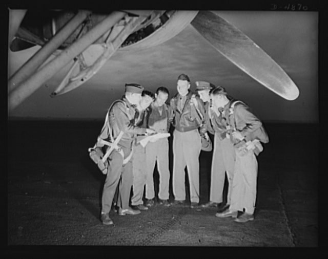 """Langley Field, Virginia. YB-17 bombardment squadron. """"Here's our mission."""" A combat crew receives final instructions just before taking off in a mighty YB-17 bomber from a bombardment squadron base at Langley Field, Virginia"""