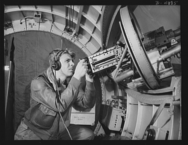 Langley Field, Virginia. YB-17 bombardment squadron. Hitler would like this man to go home and forget about the war. A good American non-com at the side machine gun of a huge YB-17 bomber is a man who knows his business and works hard at it
