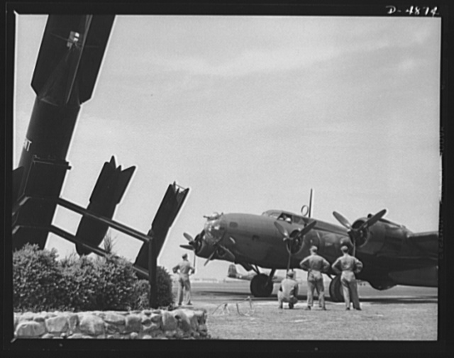 Langley Field, Virginia. YB-17 bombardment squadron. One of America's new warships of the air, a mighty YB-17 bomber, is pulled up at a bombardment squadron hanger at Langley Field, Virginia. It is all set to taxi out to a runway and take off