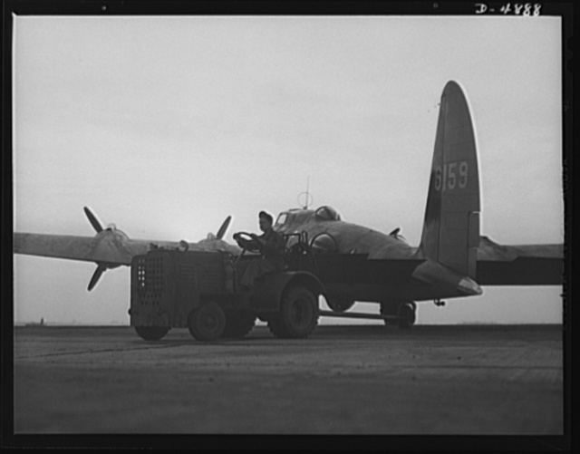 Langley Field, Virginia. YB-17 bombardment squadron. One of Uncle Sam's mighty warships of the air is berthed at Langley Field, Virginia. A tow-car returns a YB-17 bomber to a hanger of the bombardment squadron for which it has just completed a mission