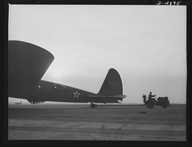 Langley Field, Virginia. YB-17 bombardment squadron. One of Uncle Sam's mighty warships of the air is berthed at Langley Field, Virginia. A tow car returning a YB-17 bomber to the hanger of the bombardment squadron for which it has just completed a mission