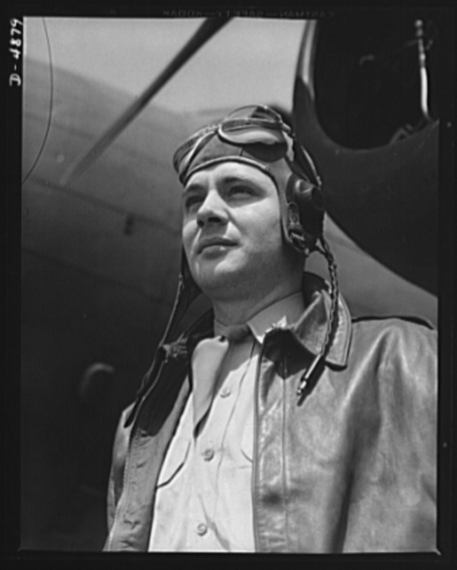 Langley Field, Virginia. YB-17 bombardment squadron. The kind of man Hitler wishes we didn't have. A bomber pilot, captain in a bombardment squadron stationed at Langley Field, Virginia, just before he climbs aboard his huge YB-17 bombing plane