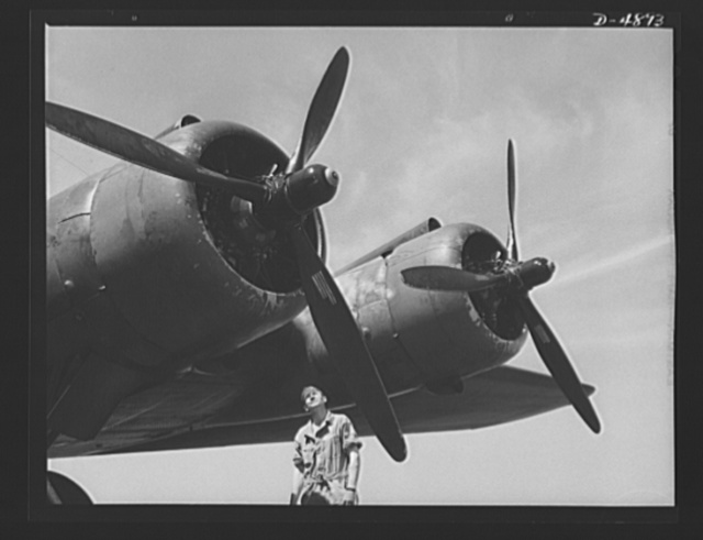 Langley Field, Virginia. YB-17 bombardment squadron. The men who keep them flying are proud of Uncle Sam's new warships of the skies. A master sergeant of a bombardment squadron at Langley Field, Virginia turns a fond but critical eye on one of the four powerful motors of a giant YB-17 bomber