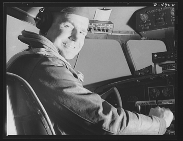 Langley Field, Virginia. YB-17 bombardment squadron. When it comes to getting action out of a big bomber, he has what it takes. A captain of a bombardment squadron stationed at Langley Field, Virginia is at the controls of the mighty YB-17 bomber he pilots