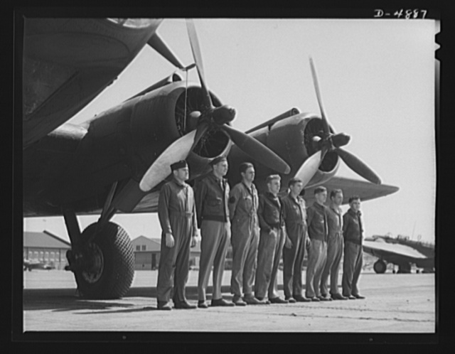 Langley Field, Virginia. YB-17 bombardment squadrons. A combat crew of one of our mighty YB-17 bombers lines up before a warship of the skies. A captain and lieutenant act as pilot and co-pilot. Two sergeants and four corporals man the machine guns, radio and other equipment. All belong to a bombardment squadron stationed at Langley Field, Virginia