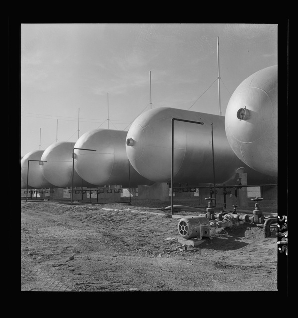 Las Vegas, Nevada. Like a row of dirigible balloons, the propane gas storage tanks rest upon the floor of the southern Nevada desert at Basic Magnesium's giant plant, where magnesium is produced