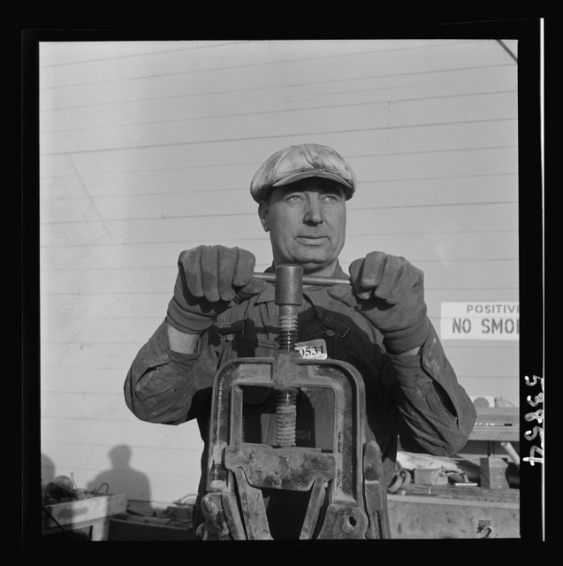 Las Vegas, Nevada. One of the construction workers at the Basic Magnesium Incorporated plant, working at the pipe vise. He is working on a building near the peat storage building shown in the background