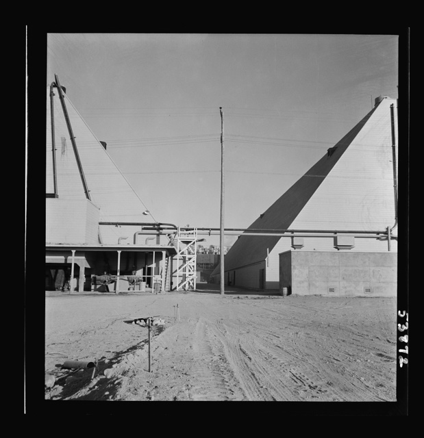 Las Vegas, Nevada. Two peat storage buildings, 540 by 100 feet, on the Basic Magnesium Incorporated grounds in the southern Nevada desert, which produces great quantities of the lightest of all metals for aircraft manufacture