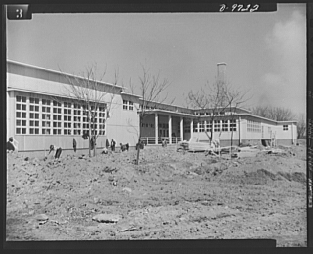 Latest addition to D.C. War Housing Program. To relieve the shortage of housing for Negro women war workers in Washington, the Federal Works Agency (FWA) is completing construction of Wake and Midway Halls, which will accommodate 1,000 women. The project was erected by Samuel Plato, Negro contractor, at a cost of $1,600,000. Photo shows front elevation of the dining room and recreation buildings attached to the structure