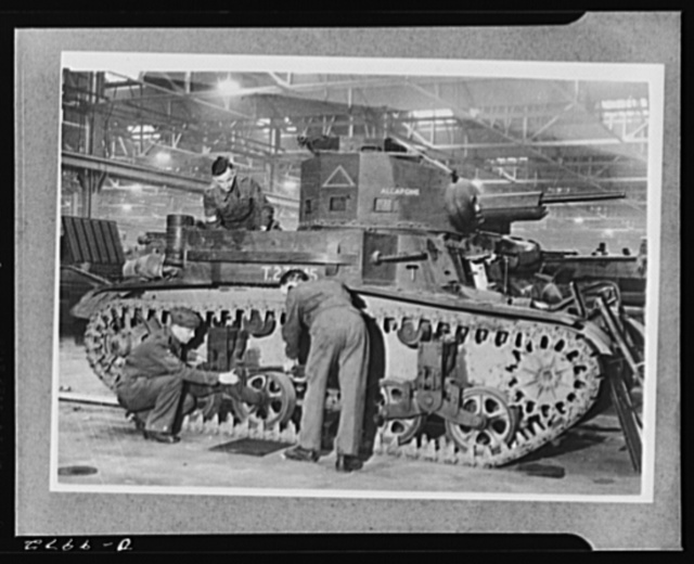 Lend-Lease to Britain. Fitters are at work assembling an American light tank which has just arrived at an English ordnance depot from the United States as part of a lend-lease shipment