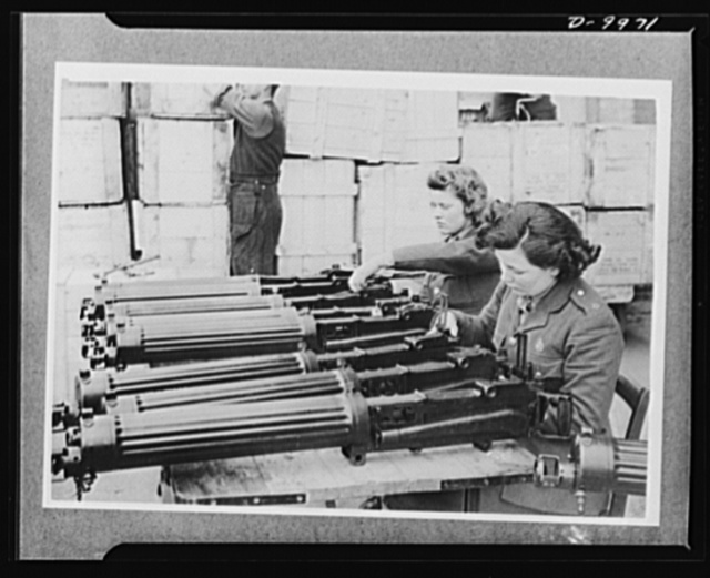 Lend-Lease to Britain. Water-cooled machine guns just arrived from the United States under lend-lease are checked at an ordnance depot in England