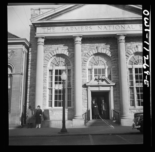 Lititz, Pennsylvania. Air raid wardens on duty and passersby taking shelter in the bank doorway during an raid drill
