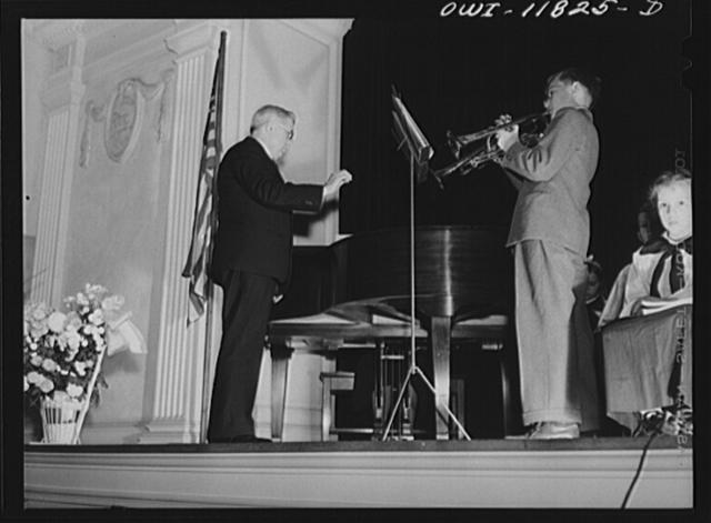 Lititz, Pennsylvania. Benny Lutz conducting trumpet players in one of his own compositions at a junior choir performance in the Moravian Sunday school