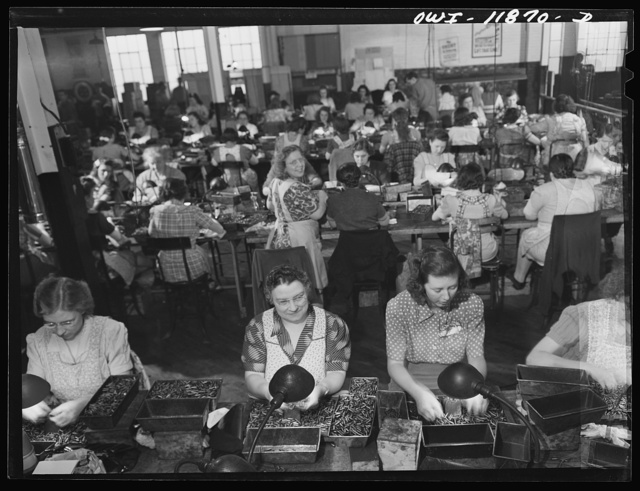 Lititz, Pennsylvania. Gauge inspectors at the Animal Trap Company. Right front is Mrs. Julian Bachman, twenty-three, whose husband is in the Army