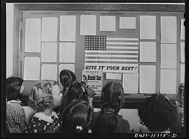 Lititz, Pennsylvania. Honor roll in the hall of the Lititz Borough Public School, showing which classes have 100 percent record for buying war stamps and bonds for the week. During the week of November 12th, out of the 845 children in the school, 780 children bought four hundred seventy-three dollars and ninety-five cents worth of stamps and bonds; two thousand seven hundred twenty-seven dollars and thirty cents worth this year