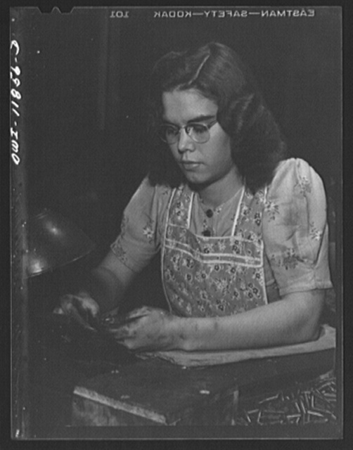 Lititz, Pennsylvania. Josephine Young gauge inspecting bullets at the Animal Trap Company. She is only sixteen and would not have been allowed to work until the new law was passed
