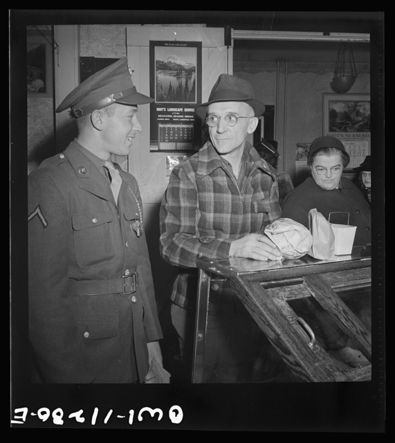 Lititz, Pennsylvania. Private first class Fred D. Long, home on leave from Fort Bliss, Texas, goes shopping with his father, Albert K. Long, who works in the animal trap company's machine shop