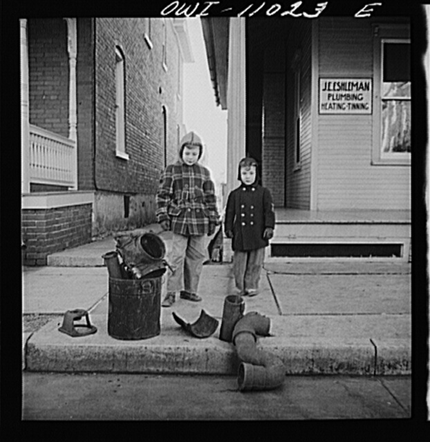 Lititz, Pennsylvania. Scrap collection drive. Each household placed its contribution on the sidewalk. It was then picked up by local trucks whose owners had volunteered their services for civilian defense. The scrap outside a plumber's house consists of pipes