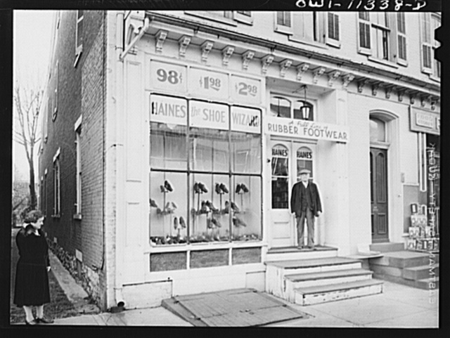 Lititz, Pennsylvania. Shoe store on main street in the early morning. Farmers must get permission from the rationing board to buy rubber boots