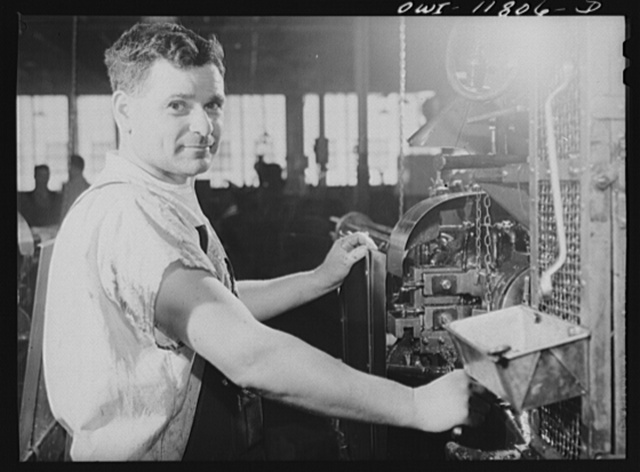 Lititz, Pennsylvania. This man is a German refugee who was a machine-gunner in the German army in the last war. Now he is making machine gun ammunition to fight Hitler