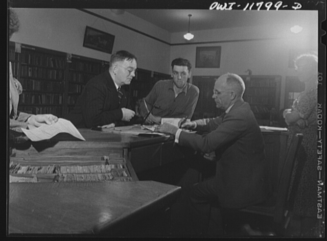 Lititz, Pennsylvania. Tire registration took place in the library of the schoolhouse, supervised by principal M.C. Demmy. Mr. Demmy is signing the papers of O.K. Bushong, the express agent