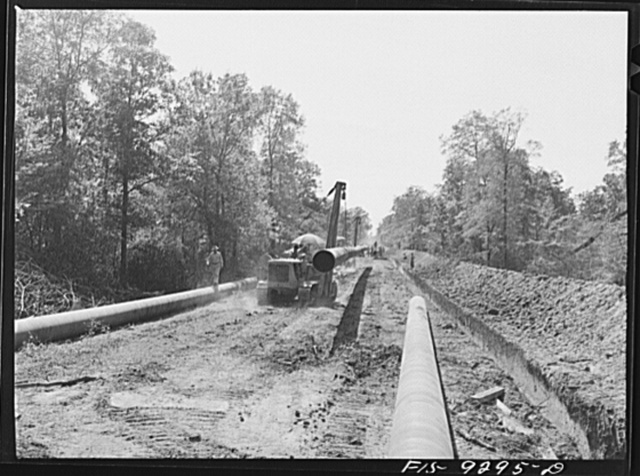 Little Rock, Arkansas to Missouri-Arkansas state line. War emergency pipeline from Longview, Texas to Norris City, Illinois. Bringing a forty-foot section to main line in stove pipe method of welding
