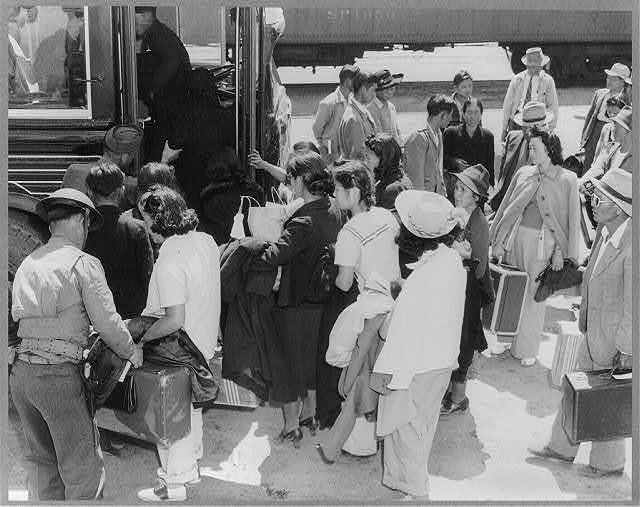 Lone Pine, Calif., May 1942 - a group arriving by train from Elk Grove, and boarding a bus for Manzanar, a War relocation authority center where evacuees of Japanese ancestry from certain West Coast area[s], will stay for the duration of the war