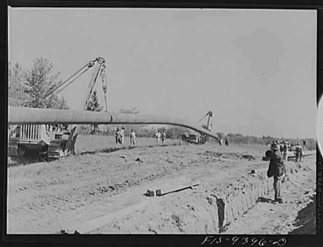 Longview, Texas to Arkansas state line. War emergency pipeline from Longview, Texas to Norris City, Illinois. Moving 200 foot section of pipe welded to main line by firing line method