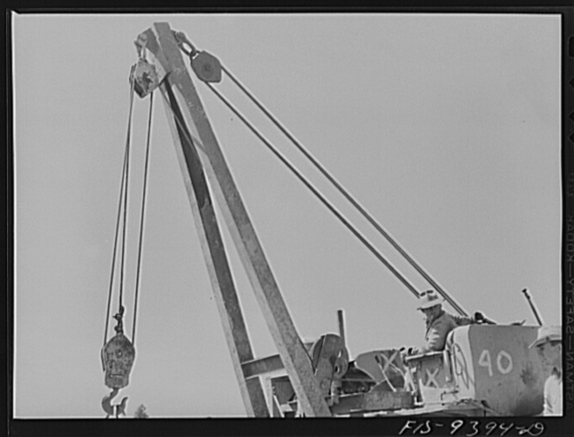 Longview, Texas to Arkansas state line. War emergency pipeline from Longview, Texas to Norris City, Illinios. Caterpillar tractor and crane used in hoisting sections of pipe