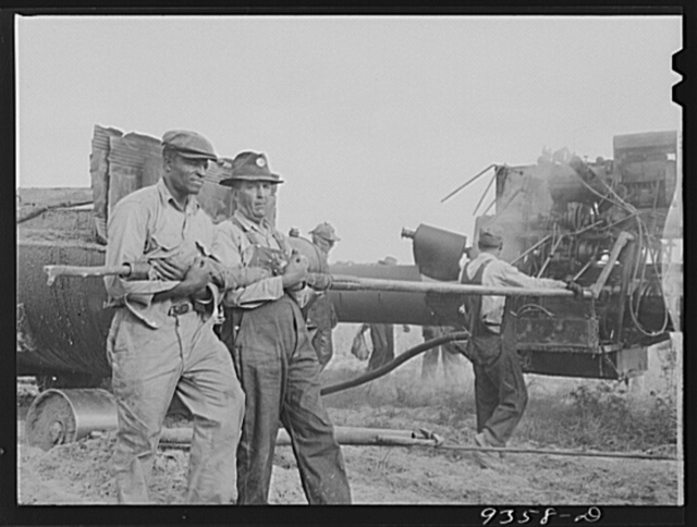 Longview, Texas to Arkansas state line. War emergency pipeline from Longview, Texas to Norris City, Illinois. Doping crew wrapping pipe with felt
