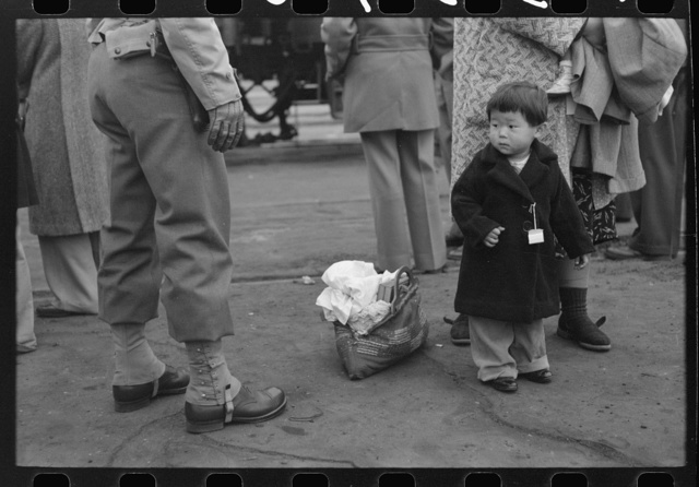 Los Angeles, California. Japanese-American evacuation from West Coast areas under U.S. Army war emergency order. Japanese-American child who will go with his parents to Owens Valley