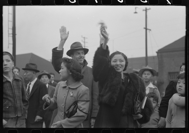 Los Angeles, California. Japanese-American evacuation from West Coast areas under U.S. Army war emergency order. Waving good-bye to friends and relatives who are leaving for Owens Valley