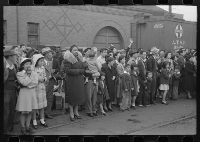 Los Angeles, California. Japanese-American evacuation from West Coast areas under U.S. Army war emergency order. Waiting for a train which will take them to Owens Valley
