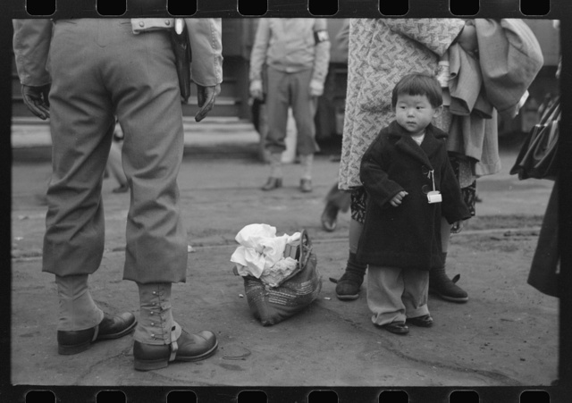 Los Angeles, California. The evacuation of Japanese-Americans from West Coast areas under U.S. Army war emergency order. Japanese-American family waiting for train to take them to Owens Valley