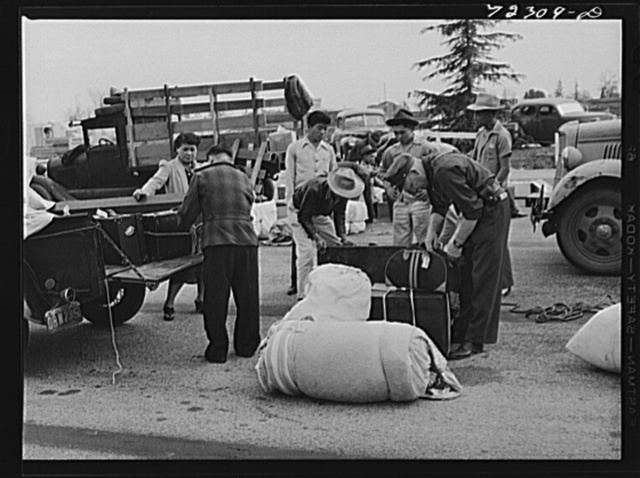 Los Angeles County, California. The evacuation of Japanese and Japanese-Americans from West coast areas under United States Army war emergency order. Luggage of the Japanese being examined when they arrive at the Santa Anita reception center