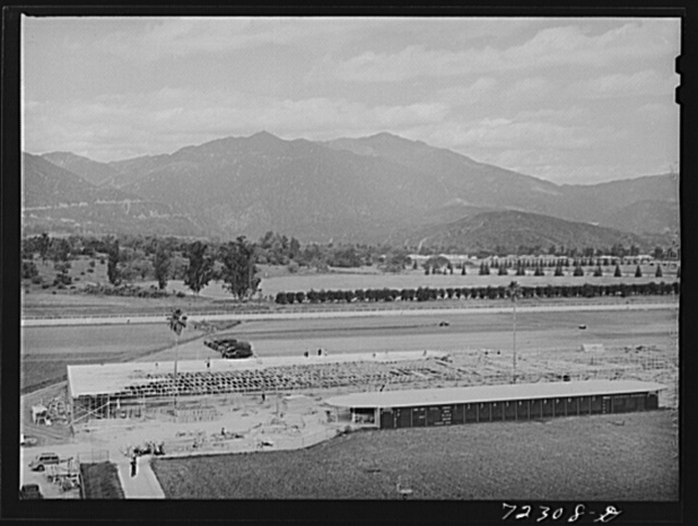 Los Angeles County, California. The evacuation of Japanese and Japanese-Americans from West coast areas under United States Army war emergency order. Part of the Santa Anita racetrack which is being converted into the reception center