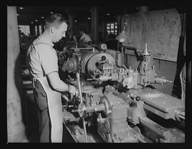 Machine for making torpedoes. Complicated operation of a turret lathe is this man's specialty. Location: a large eastern Navy arsenal