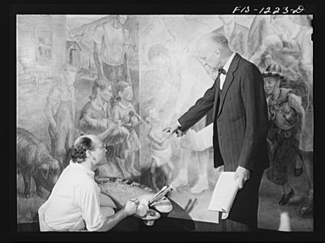 Madison, Wisconsin. John Stuart Curry discussing his mural in the biochemistry building at the University of Wisconsin with Dr. H. Steenback, expert on diet and radiation of food