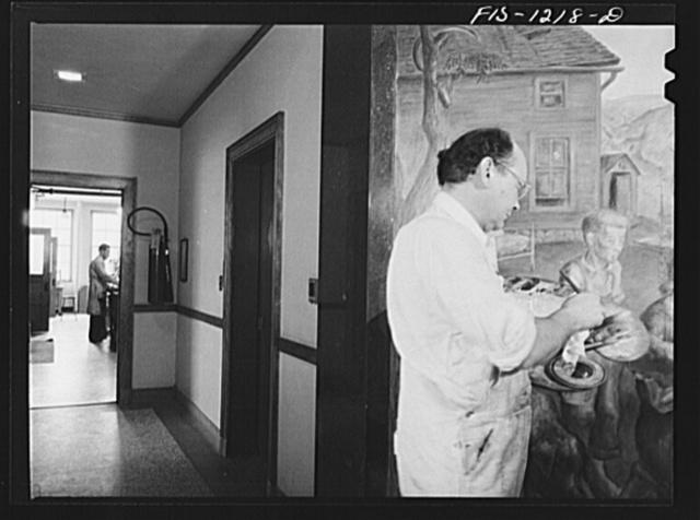 Madison, Wisconsin. John Stuart Curry, working on his mural in the biochemistry building at the University of Wisconsin. In the background is the chemistry laboratory